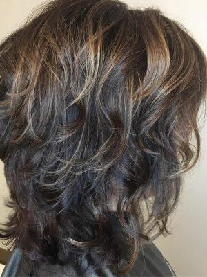 Shag bruna riccia per capelli medi